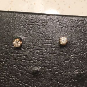 Pair of 14k Pierced Diamond Studs, .25 ct weight.